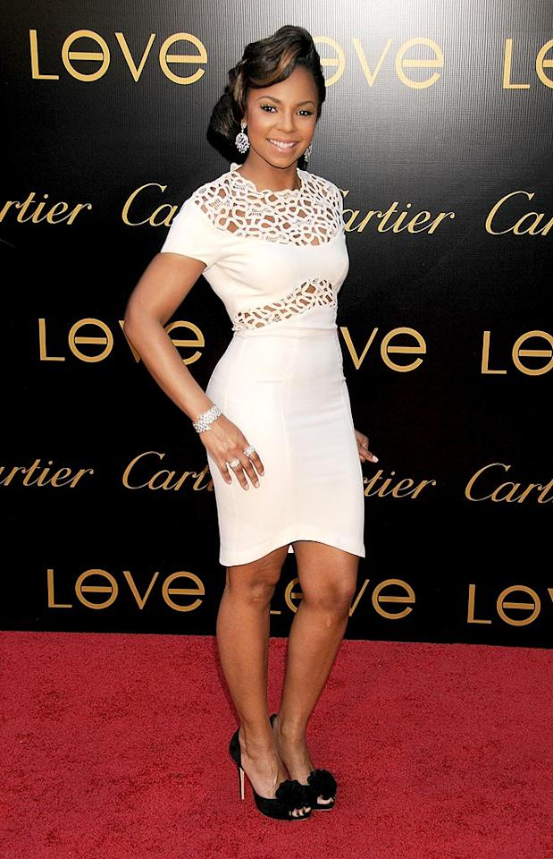 "Ashanti does herself a disservice by donning a doily-like dress. The atrocity atop her head and the contrasting shoes complete her catastrophic look. Gregg DeGuire/<a href=""http://www.wireimage.com"" target=""new"">WireImage.com</a> - June 18, 2008"
