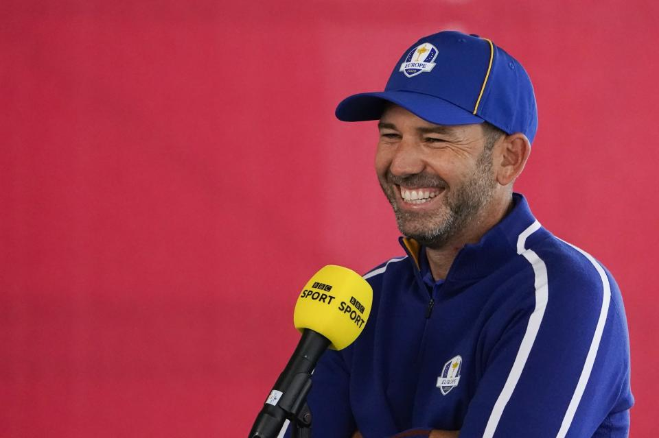 Team Europe's Sergio Garcia smiles as he answers questions during a practice day at the Ryder Cup at the Whistling Straits Golf Course Tuesday, Sept. 21, 2021, in Sheboygan, Wis. (AP Photo/Jeff Roberson)