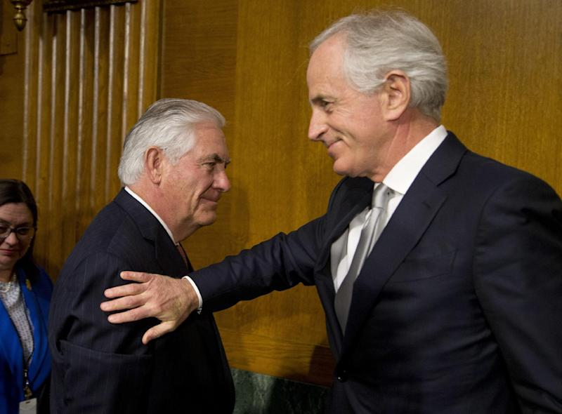 Sen. Bob Corker, R-Tenn., chairman of the Senate Foreign Relations Committee,, right, pats Secretary of State-designate Rex Tillerson , left, on the shoulder after his testimony before the Senate Foreign Relations Committee on Capitol Hill in Washington, Wednesday, Jan. 11, 2017, (AP Photo/Steve Helber)