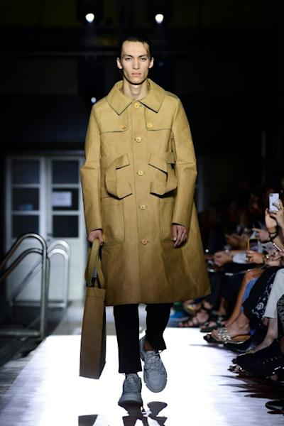 """Benetton's environmentally-aware paper trench coat can't go in the washing machine, but could """"last months or even years"""" it's designer Jean-Charles de Castelbajac says (AFP Photo/Miguel MEDINA)"""