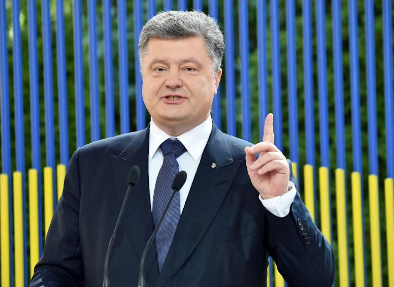 Ukrainian Prsident Petro Poroshenko said Monday's reported tank battles around Novolaspa and Sunday's attack on the OSCE vehicles were all part of the rebels' attempt to raise tensions and erase any achievements of the February truce (AFP Photo/Sergei Supinsky)