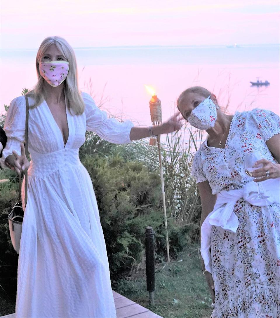 <p>Christie Brinkley and Katie Couric get goofy in their masks during a special screening of IFC Films' <em>Summerland</em> and <em>Made in Italy,</em> hosted by Donna Karan at her home in East Hampton on Thursday night. </p>