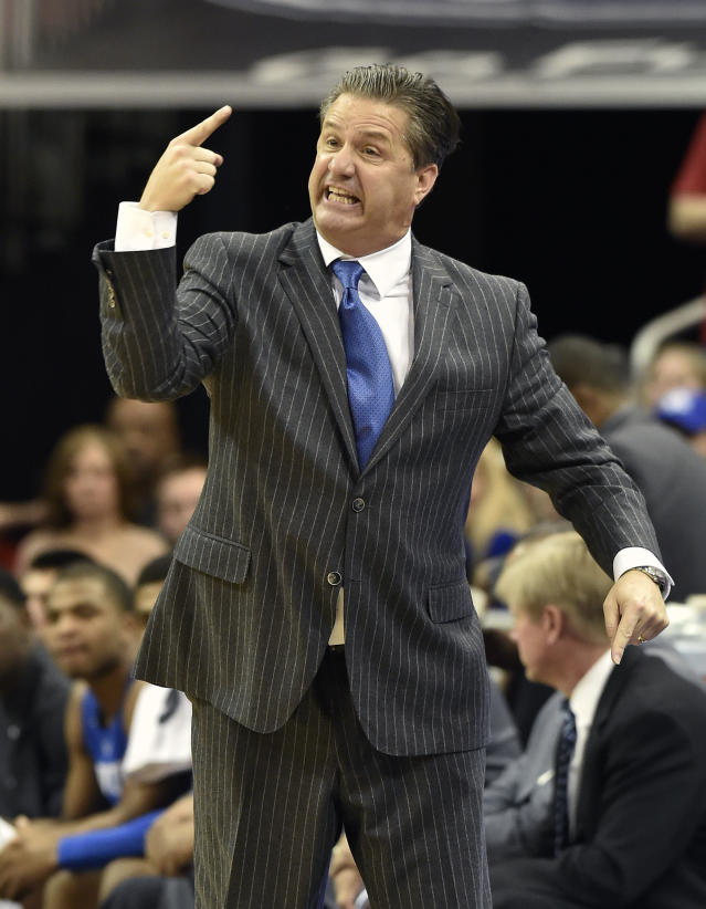 Kentucky Coach John Calipari shouts at his team during the first half of an NCAA college basketball game against Louisville, Saturday Dec. 27, 2014, in Louisville, Ky. Kentucky won 58-50. (AP Photo/Timothy D. Easley)