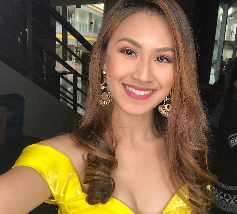 Christine Angelica Dacera smiles while wearing a bright yellow dress. Source: Newsflash/Australscope