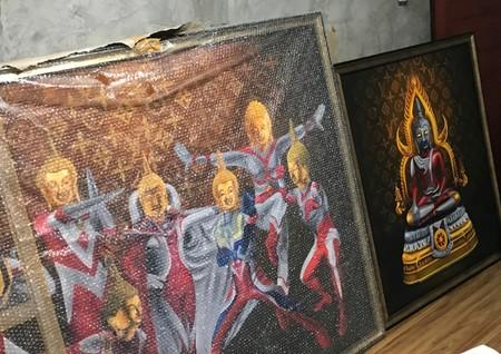 "Paintings of Japanese superhero ""Ultraman"" with Thai-style Buddha's head are seen in Bangkok"