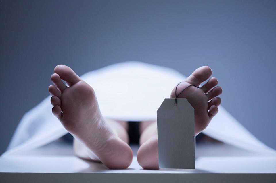 dead body with toe tag, skin cancer facts