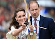<p>Is it Kate or Cupid? While visiting Bhutan, the Duchess fired an arrow at an archery demonstration. Prince William, gazing on, looked a tad concerned. </p>