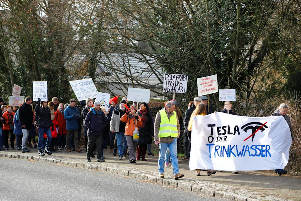 Demonstrators hold anti-Tesla posters during a protest against plans by U.S. electric vehicle pioneer Tesla to build its first European factory and design center in Gruenheide near Berlin, Germany January 18, 2020. REUTERS/Pawel Kopczynski