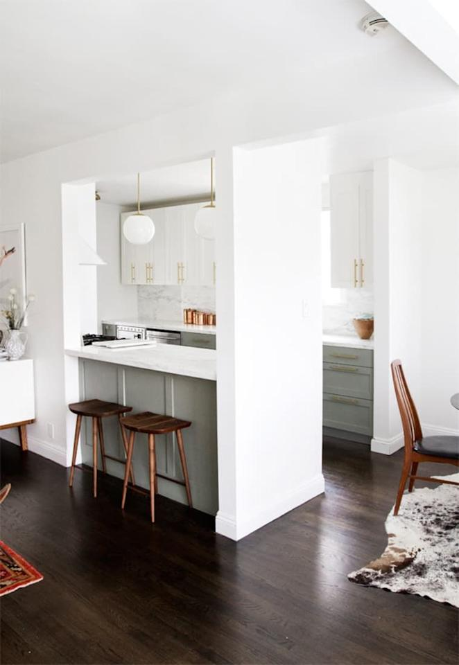 """<p>One way to make your galley kitchen feel less like a hallway? Open it up! And no, you don't need to demo an entire wall to do so, as Sarah Sherman Samuel proves here in this serene California cook space.</p><p><strong>See more at <a href=""""https://sarahshermansamuel.com/kitchen-before-after/"""" target=""""_blank"""">Sarah Sherman Samuel</a>.</strong></p>"""