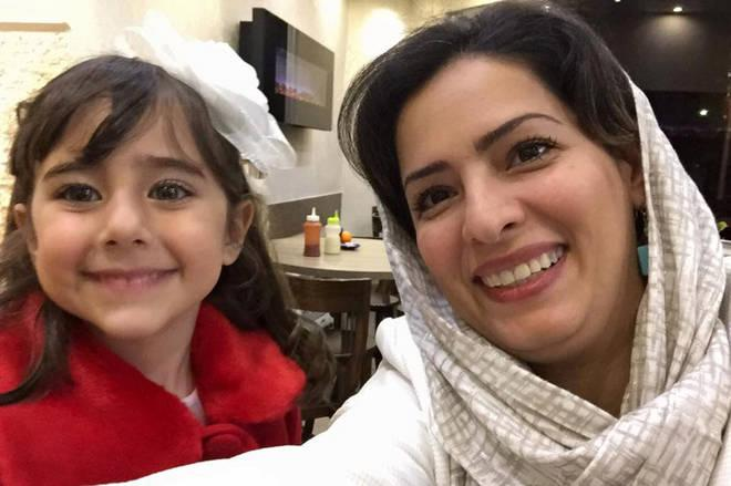 Reera Esmaeilion poses with a photo with her mother Parisa Eghbalian. Both were killed on board Ukraine Airlines Flight PS752, which was shot down by Iran.