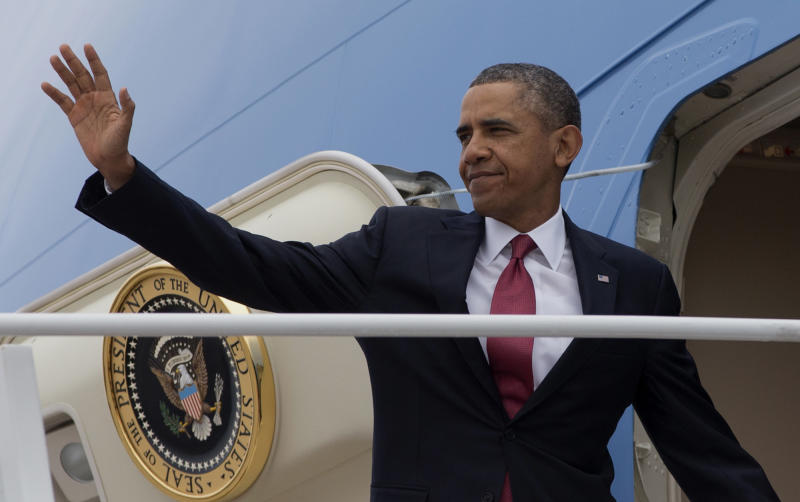 President Barack Obama waves as he boards Air Force One, Wednesday, Jan. 15, 2014, at Andrews Air Force Base, Md. before traveling to North Carolina where he will speak about the economy. (AP Photo/Carolyn Kaster)