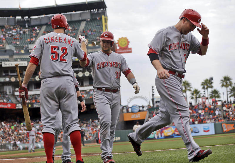 Cincinnati Reds' Devin Mesoraco, center, is greeted by Tony Cingrani (52) after his three-run home run during the second inning of the first game of a baseball doubleheader against the San Francisco Giants on Tuesday, July 23, 2013, in San Francisco. At right is Todd Frazier. (AP Photo/Marcio Jose Sanchez)