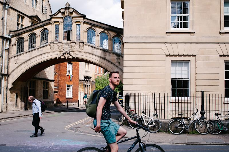 Cyclists and pedestrians pass the Hertford Bridge, typically known as the 'Bridge of Sighs', on New College Lane in Oxford, England, on June 22, 2019. (Photo by David Cliff/NurPhoto via Getty Images)