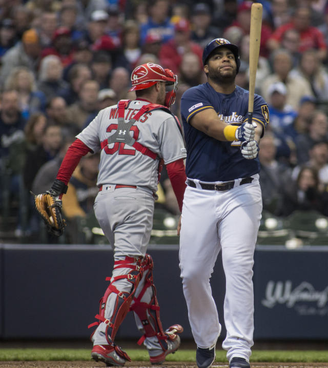 Milwaukee Brewers first baseman Jesus Aguilar, right, reacts after being called out against the St. Louis Cardinals during the second inning of a baseball game Wednesday, April 17, 2019, in Milwaukee. (AP Photo/Darren Hauck)