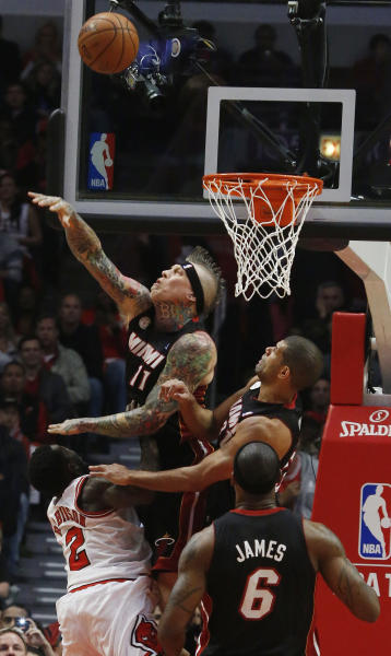 Miami Heat power forward Chris Andersen (11) knocks the ball away against a Chicago Bulls offense during the first half of Game 3 of an NBA basketball playoffs Eastern Conference semifinal on Friday, May 10, 2013, in Chicago. (AP Photo/Charles Rex Arbogast)