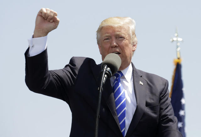 <p>President Donald Trump pumps his fist as he addresses the graduating class of the U.S. Coast Guard Academy during commencement ceremonies in New London, Connecticut, May 17, 2017. (Photo: Kevin Lamarque/Reuters) </p>