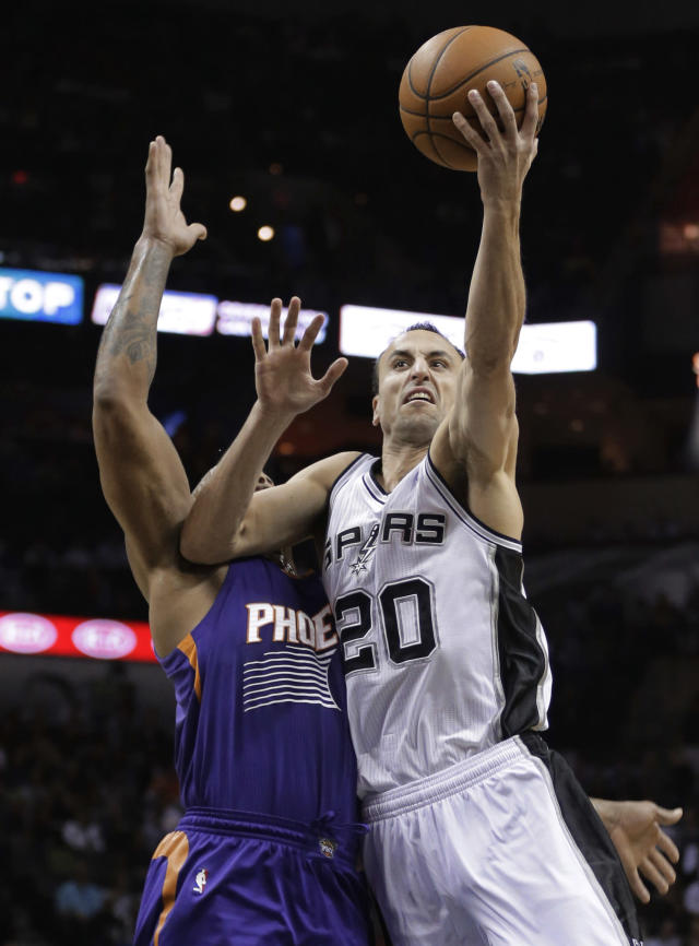 San Antonio Spurs' Manu Ginobili (20), of Argentina, shoots in front of Phoenix Suns' P.J. Tucker during the first half of an NBA basketball game, Wednesday, Nov. 6, 2013, in San Antonio. (AP Photo/Eric Gay)
