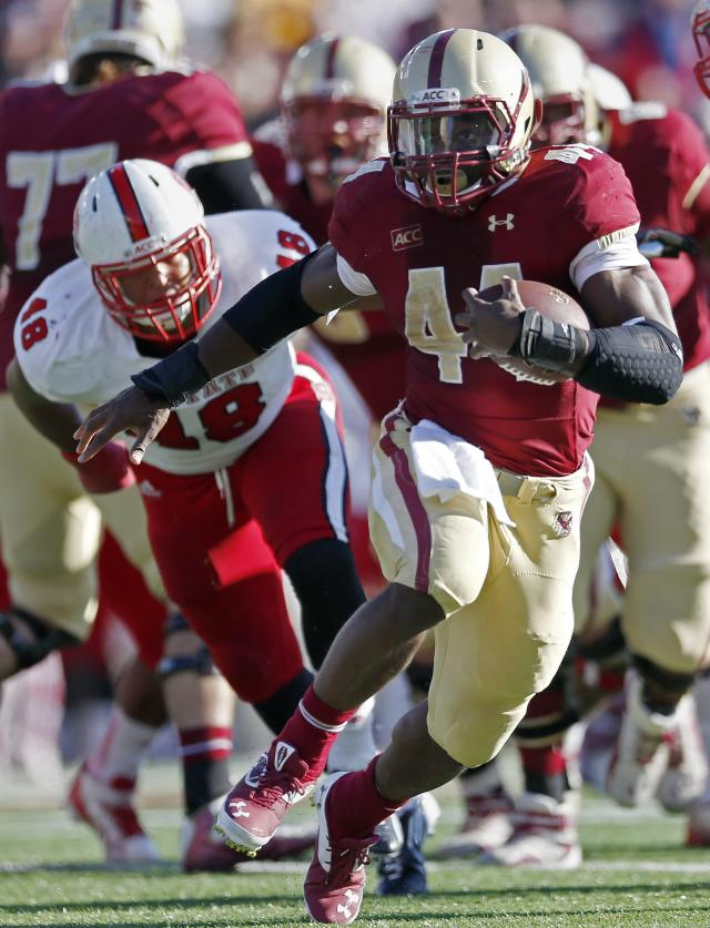 Boston College running back Andre Williams (44) runs ahead of North Carolina State linebacker Robert Caldwell (48) in the first quarter of an NCAA college football game in Boston, Saturday, Nov. 16, 2013. (AP Photo/Michael Dwyer)