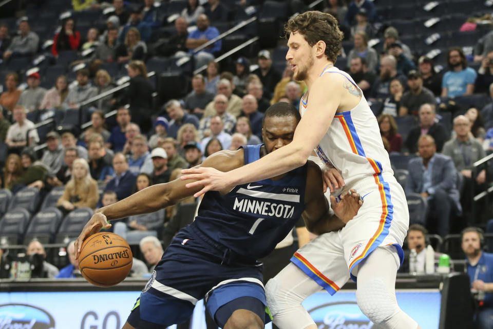 Minnesota Timberwolves' Noah Vonleh, left, runs into Oklahoma City Thunder's Mike Muscala in the first half of an NBA basketball game Monday, Jan. 13, 2020, in Minneapolis. (AP Photo/Jim Mone)
