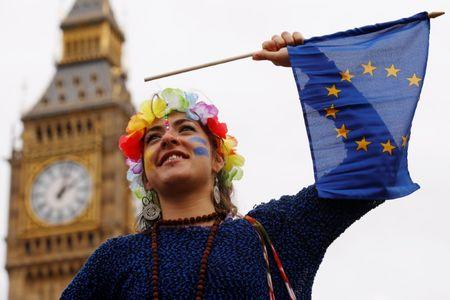 "A Pro-Europe demonstrator waves a flag during a ""March for Europe"" protest against the Brexit vote result earlier in the year, in London, Britain"