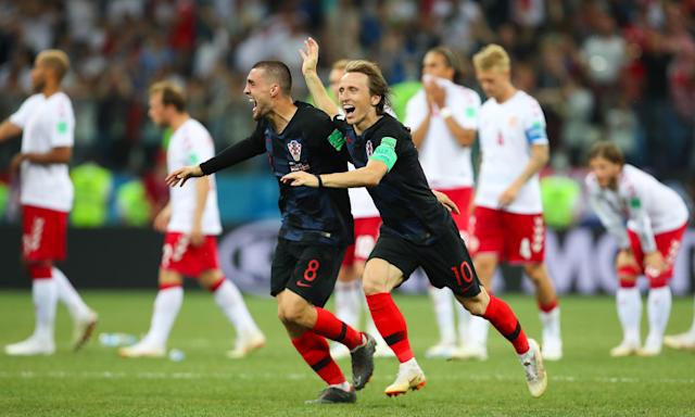 Luka Modric (right) reacts to Croatia's winning penalty against Denmark.