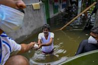 Army personnel distribute food to flood victims after heavy monsoon rains in Kelaniya