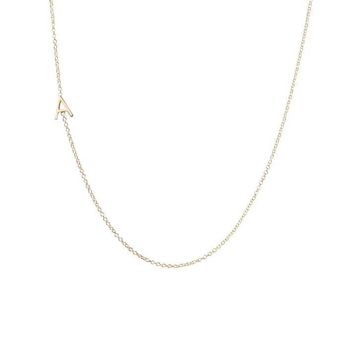 """Maya Brenner's elegant initial chains stand out in a sea of customizable options because of how special they look on: The letter rests gently on the side of the collarbone, and you can add up to three initials. $240, Mark and Graham. <a href=""""https://www.markandgraham.com/products/maya-brenner-asymmetrical-initial-necklace-gold/?"""" rel=""""nofollow noopener"""" target=""""_blank"""" data-ylk=""""slk:Get it now!"""" class=""""link rapid-noclick-resp"""">Get it now!</a>"""