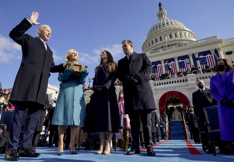 Joe Biden is sworn in as the 46th president of the United States by Chief Justice John Roberts as Jill Biden holds the Bible during the 59th Presidential Inauguration. (Andrew Harnik, Pool/AP Photo)