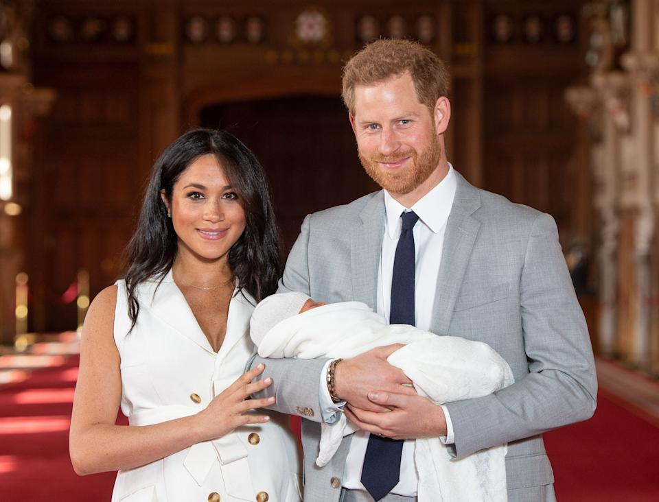 British Prince Harry, Duke of Sussex (R) and his wife Meghan, Duchess of Sussex, are photographed with their newborn son Archie Harrison Mountbatten-Windsor at St George's Hall in Windsor Castle in Windsor, west of London.  May 8, 2019 (Photo by Dominic Lipinski / POOL / AFP) (Photographer should read DOMINIC LIPINSKI / AFP via Getty Images)