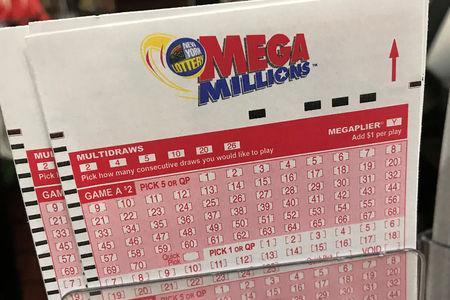 FILE PHOTO: A Mega Millions ticket is pictured in a store in New York City, New York, U.S., January 5, 2018. REUTERS/Carlo Allegri/File Photo