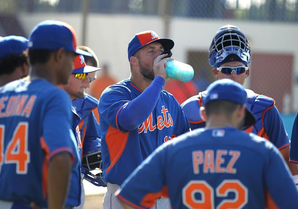 <p>Tim Tebow, center, takes a drink during a practice before his first instructional league baseball game for the New York Mets against the St. Louis Cardinals instructional club Wednesday, Sept. 28, 2016, in Port St. Lucie, Fla. (AP Photo/Luis M. Alvarez) </p>
