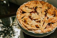 An all-time favourite, apple pie is truly a dessert that comforts the soul. Along with a hot cup of coffee, there's no better combination to keep you company on a winter's evening. INGREDIENTS: 1.5 kg pf peeled assorted apples, peeled and sliced, 2 tbsp fresh lemon juice, 2/3 cup granulated sugar, 2 tbsp all purpose flour, 1 tsp ground cinnamon, 1/2 tsp vanilla extract, 1/4 tsp salt, 2 tbsp butter, egg wash, coarse sugar for sprinkling. DIRECTIONS: Freeze your pie crust for 30 minutes before baking. Bake at 200 C. Toss apples with sugar, lemon juice, flour, vanilla and cinnamon. Transfer to the crust-lined pie dish. Dot with butter all over. Drape over the pie pastry in tour desired design, covering the pie filling. Brush with egg wash and sprinkle with coarse sugar. Place pie on to pre-heated baking sheet and bake for 20 minutes. Reduce heat to 160 C, and bake for another 40 minutes. Cool before serving!