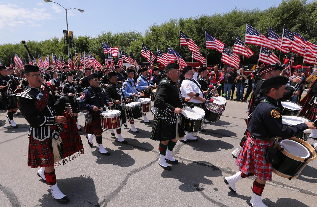 Bagpipers from across the country march in a procession to a memorial service for first responders who died in last week's fertilizer plant explosion in West, Texas, Thursday, April 25, 2013, in Waco, Texas. President Barack Obama, U.S. Sen. John Cornyn and Texas Gov. Rick Perry are set to speak at Thursday's memorial at Baylor University's Ferrell Center in Waco. (AP Photo/Waco Tribune Herald, Rod Aydelotte)