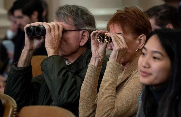PHOTO: Members of the public use binoculars as they watch the House Judiciary Committee hearing on the impeachment of President Donald Trump on Capitol Hill in Washington, Dec. 4, 2019. (Saul Loeb/AFP via Getty Images)