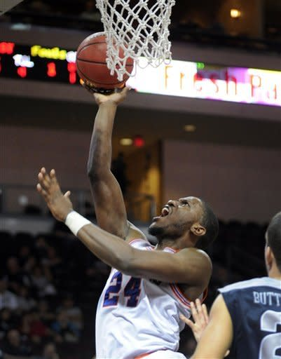 UT Arlington's Kevin Butler (24) shoots against Utah State during the second half of a Western Athletic Conference tournament NCAA college basketball game, Thursday, March 14, 2013 in Las Vegas. UT Arlington won 83-78. (AP Photo/David Becker)