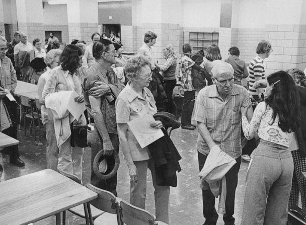 PHOTO: In this Nov. 21 1976, file photo, residents line up for free swine flu immunizations at a clinic in Denver. (Kenn Bisio/The Denver Post via Getty Images, FILE)