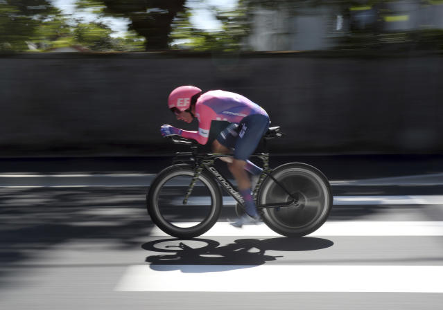 Canada's Michael Woods rides during the thirteenth stage of the Tour de France cycling race, an individual time trial over 27.2 kilometers (16.9 miles) with start and finish in Pau, France, Friday, July 19, 2019. Unusually, Woods is a rookie at cycling's greatest race at the ripe age of 32 and also has an unusual back story as a former track athlete who switched late to pro cycling. (AP Photo/Thibault Camus)