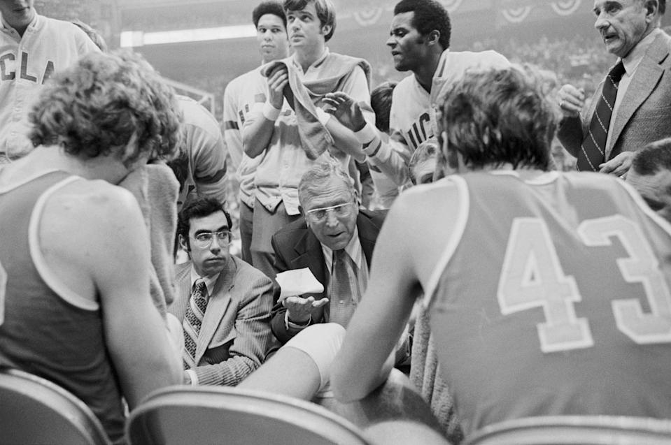 UCLA basketball coach John Wooden is shown talking to his team during a timeout during their victory in the NCAA finals against Memphis State. (AP)