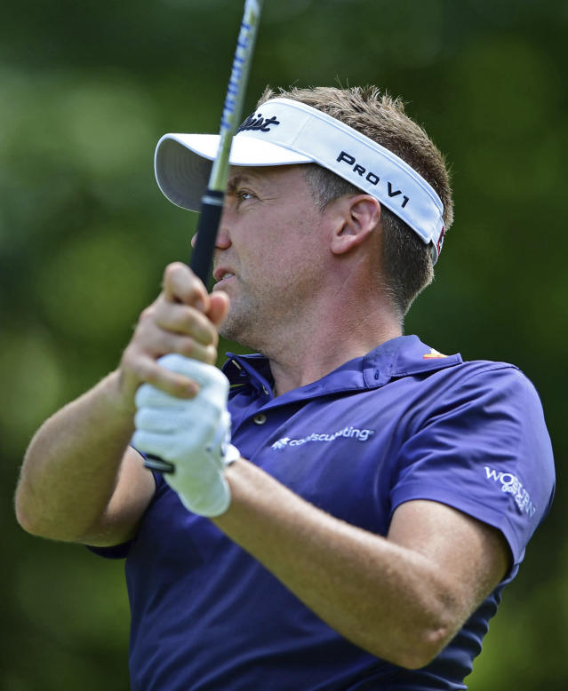 Ian Poulter, from England, watches his tee shot on the fifth hole during the third round of the Bridgestone Invitational golf tournament at Firestone Country Club, Saturday, Aug. 4, 2018, in Akron, Ohio. (AP Photo/David Dermer)
