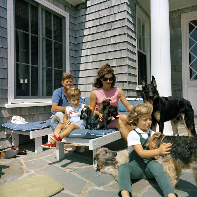 <p>President John F. Kennedy, son John F. Kennedy Jr., first lady Jacqueline Kennedy, and daughter Caroline Kennedy with family dogs in Hyannis Port, Mass., Aug. 1963. (Photo: Cecil Stoughton/White House/John Fitzgerald Kennedy Library and Museum) </p>
