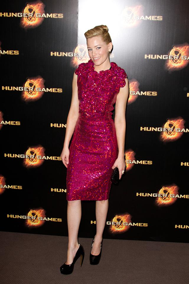"""Elizabeth Banks attends the """"Hunger Games"""" Paris Premiere photocall at Cinema Gaumont Marignan on March 15, 2012 in Paris, France. (Photo by Marc Piasecki/WireImage)"""