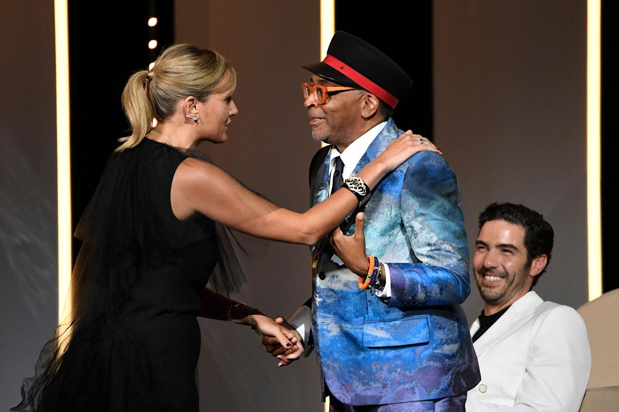 French director Julia Ducournau (L) thanks US director and Jury President of the 74th Cannes Film Festival Spike Lee after she won the Palme d'Or for her film Titane during the closing ceremony of the 74th edition of the Cannes Film Festival in Cannes.
