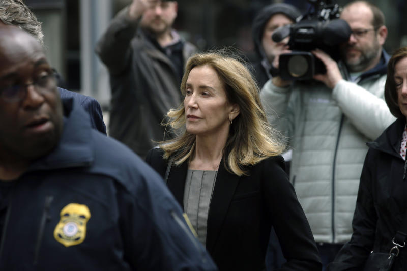 Felicity Huffman arrives at federal court Monday, May 13, 2019, in Boston, where she is scheduled to plead guilty to charges in a nationwide college admissions bribery scandal. (AP Photo/Steven Senne)