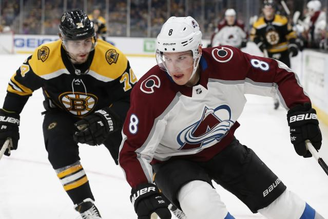 Boston Bruins' Jake DeBrusk (74) pursues Colorado Avalanche's Cale Makar (8) during the first period of an NHL hockey game in Boston, Saturday, Dec. 7, 2019. (AP Photo/Michael Dwyer)