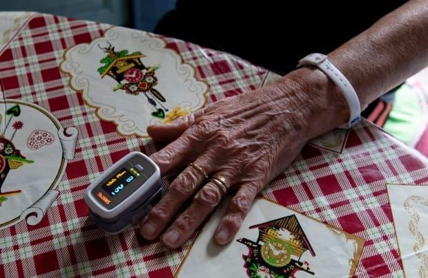 Pulse oximeters are shipped to a patient's door within 24 hours. They're told to check their oxygen levels at least twice a day. If their oxygen drops below a certain level, they're immediately admitted to the hospital.