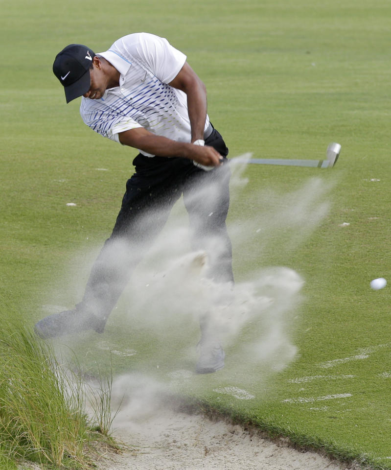 Tiger Woods hits from the sand along the seventh fairway during the third round of the PGA Championship golf tournament on the Ocean Course of the Kiawah Island Golf Resort in Kiawah Island, S.C., Saturday, Aug. 11, 2012. (AP Photo/Chuck Burton)