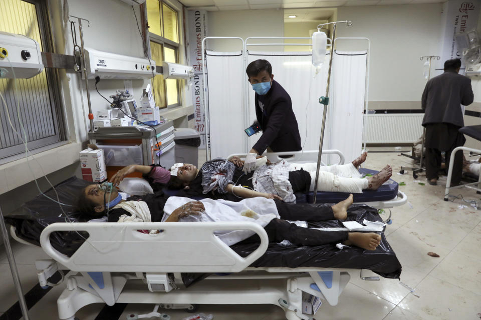 FILE - In this May 8, 2021 file photo, Afghan school students are treated at a hospital after a bomb explosion near a school in west of Kabul, Afghanistan. In a report released Monday, July 26, 2021, the United Nations said that more women and children were killed and wounded in Afghanistan in the first half of 2021 than in any year since the UN began keeping count in 2009. (AP Photo/Rahmat Gul, File)