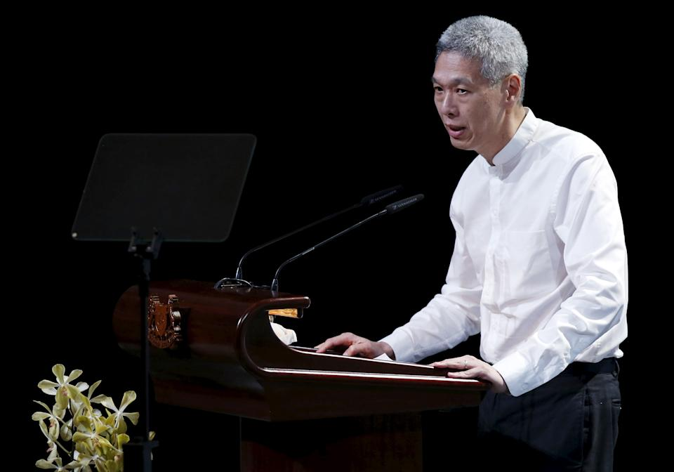 Lee Hsien Yang, son of former leader Lee Kuan Yew, delivers his eulogy during the funeral service at the University Cultural Centre at the National University of Singapore March 29, 2015. Grieving Singaporeans were joined by world leaders on Sunday to pay their final respects to the country's first prime minister, Lee Kuan Yew, as the nation came to a near-halt to honour its