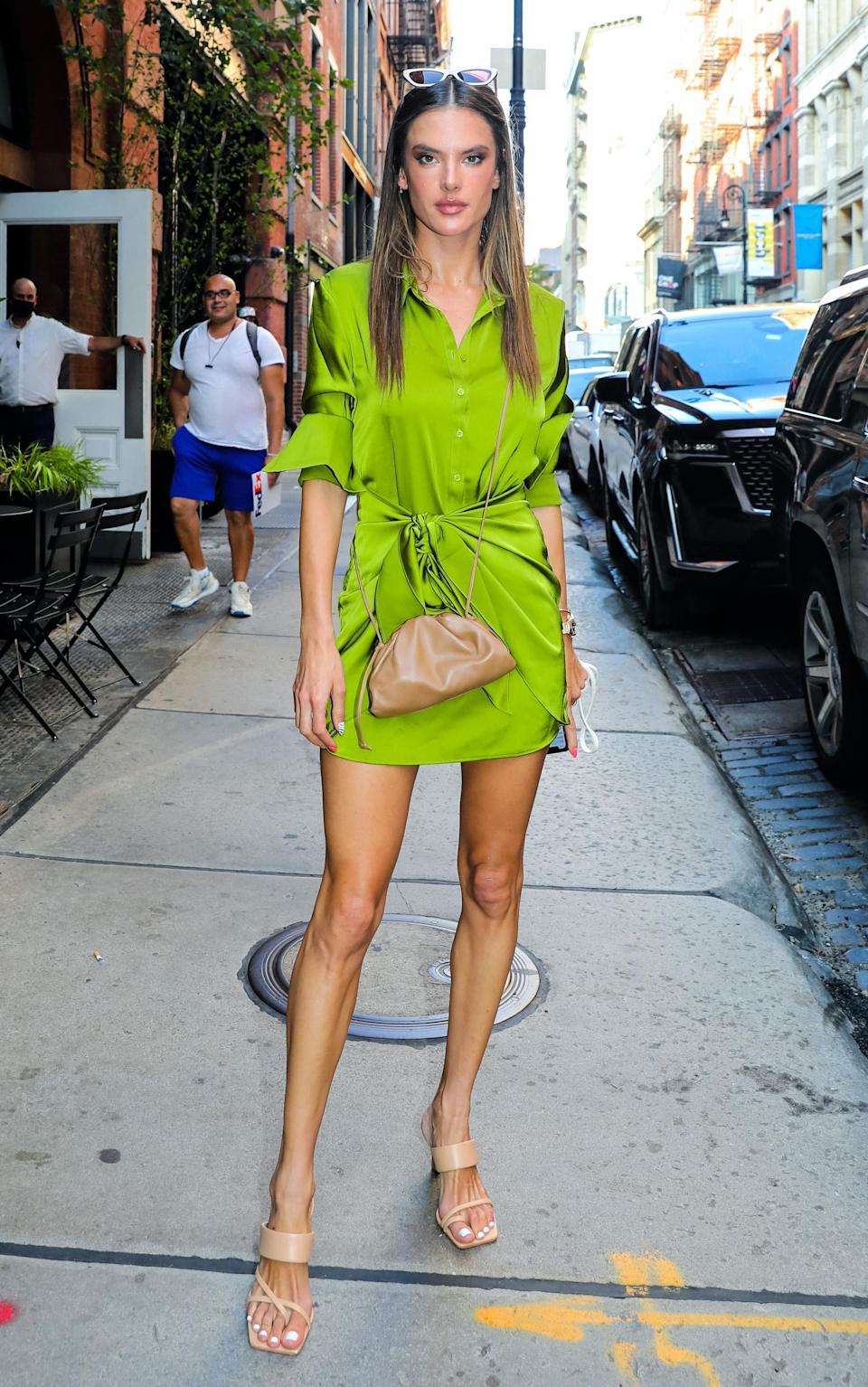 Alessandra Ambrosio celebrates the end of summer with a bold green shirt dress.  - Credit: Jose Perez / Bauergriffin.com / MEGA