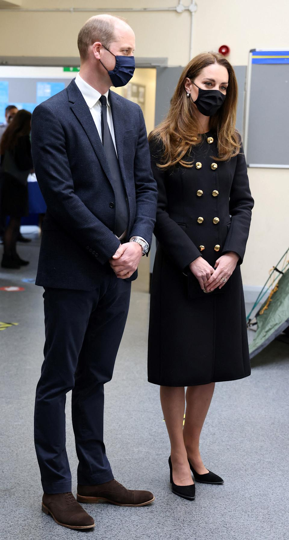 Britain's Prince William, Duke of Cambridge, and Britain's Catherine, Duchess of Cambridge, wearing black as a mark of respect following the death of Britain's Prince Philip, Duke of Edinburgh, and a face covering to combat the spread of Covid-19, talk with Air Cadets during their visit to 282 (East Ham) Squadron Air Training Corps in east London on April 21, 2021. - During the visit, the Squadron paid tribute to The Duke of Edinburgh, who served as Air Commodore-in-Chief of the Air Training Corps for 63 years. In 2015, The Duke passed the military patronage to The Duchess of Cambridge who became Honorary Air Commandant. (Photo by Ian Vogler / POOL / AFP) (Photo by IAN VOGLER/POOL/AFP via Getty Images)